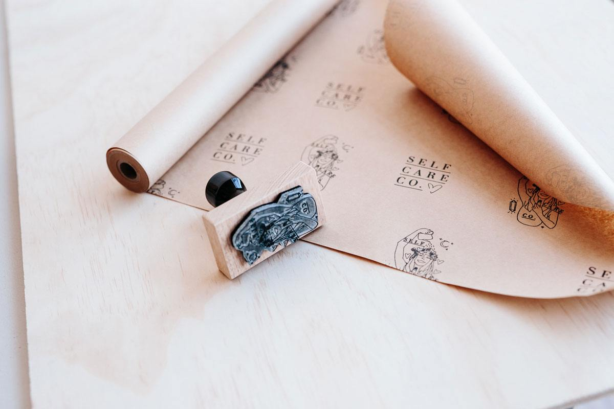 A roll of brown paper that has been custom-branded with a rubber stamp.