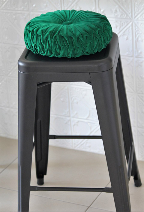 Emerald green vintage style round velvet cushion by Set Adrift