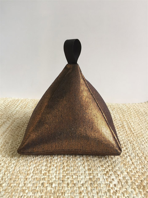 Bronze pyramid doorstop by Gozi and Pop
