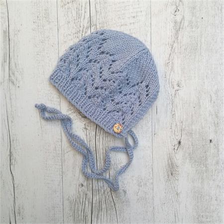 Hand-knitted bonnet