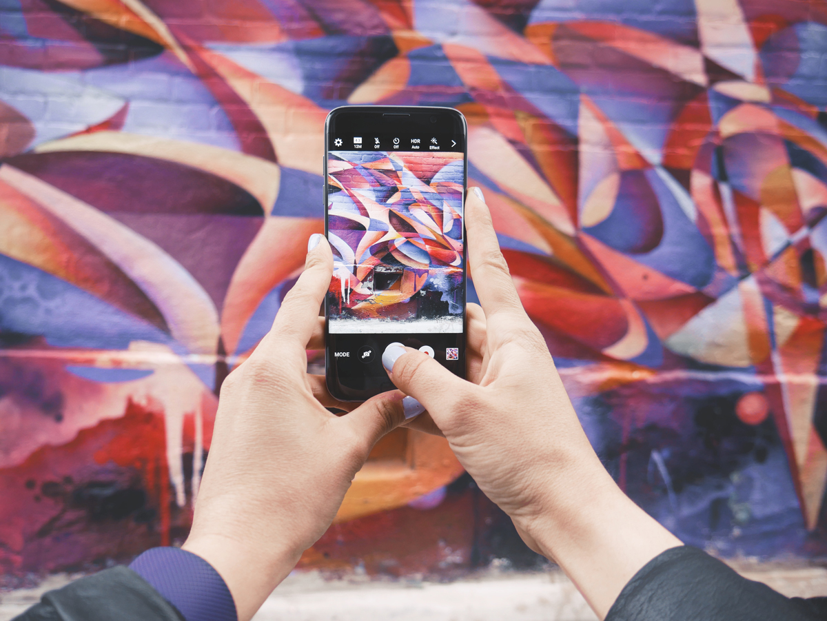 Capturing a street-art snap to share with social media followers