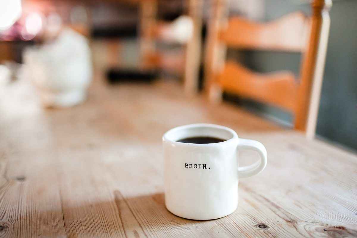 "Coffee Mug with wise words: ""Begin."""