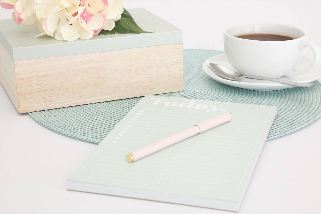 Styled product photo using a coloured placemat against a white background to add visual interest without competing with the main subject