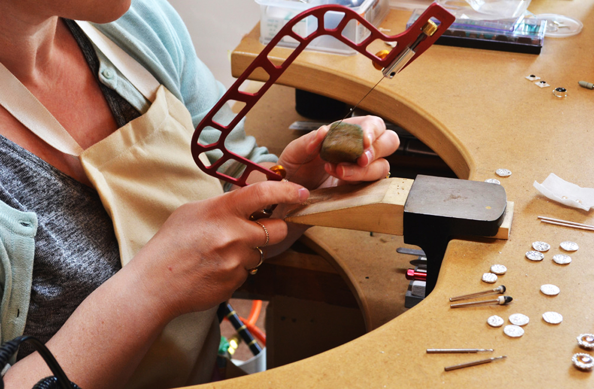 Close-up of Arita working at her jeweller's bench