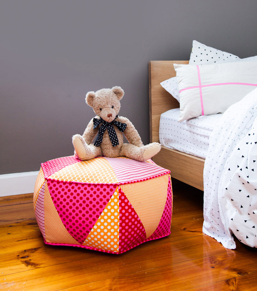 A colourful pink and gold floor pouf made from one of Anthea's patterns
