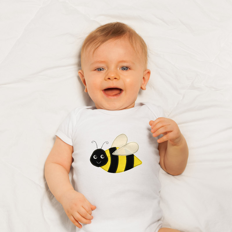Anthea's 'Bumble Bee' applique design on a baby romper.