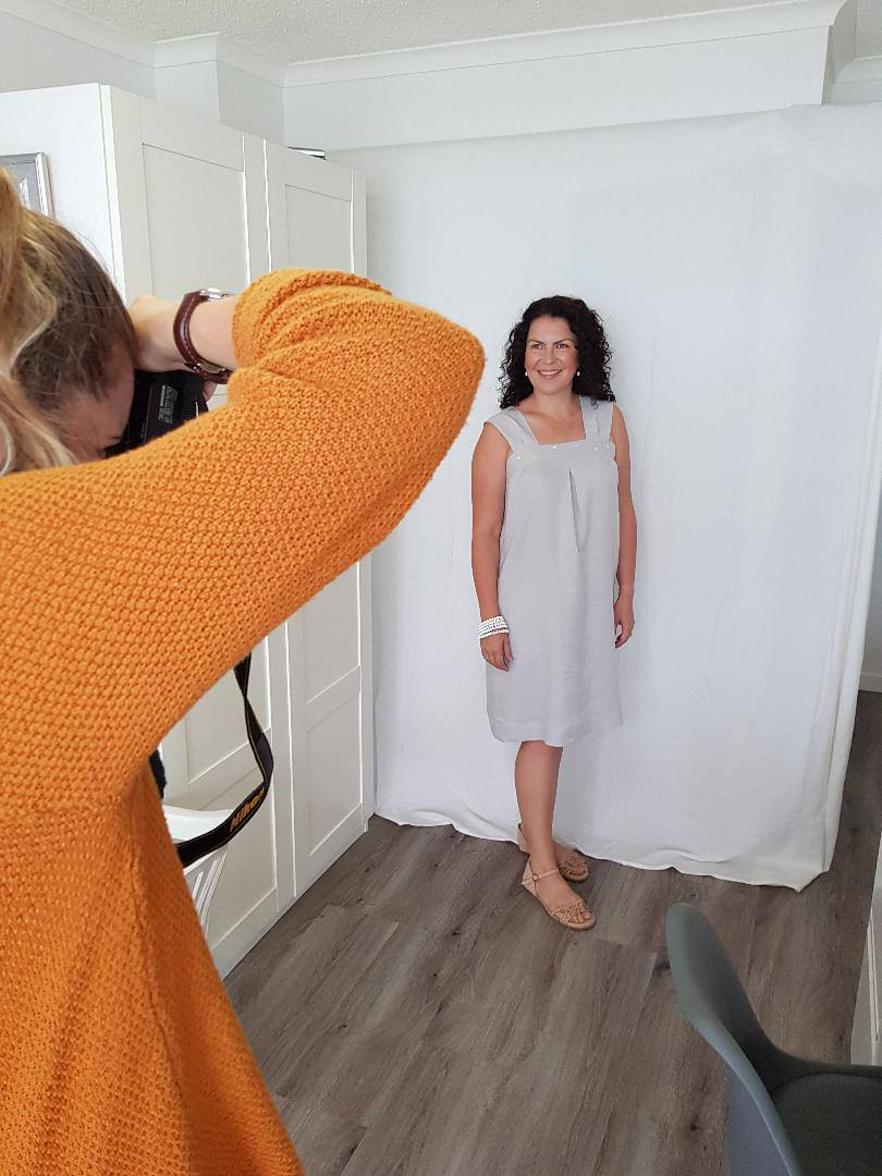 A Model posing in one of Julie's linen creations for a photoshoot.
