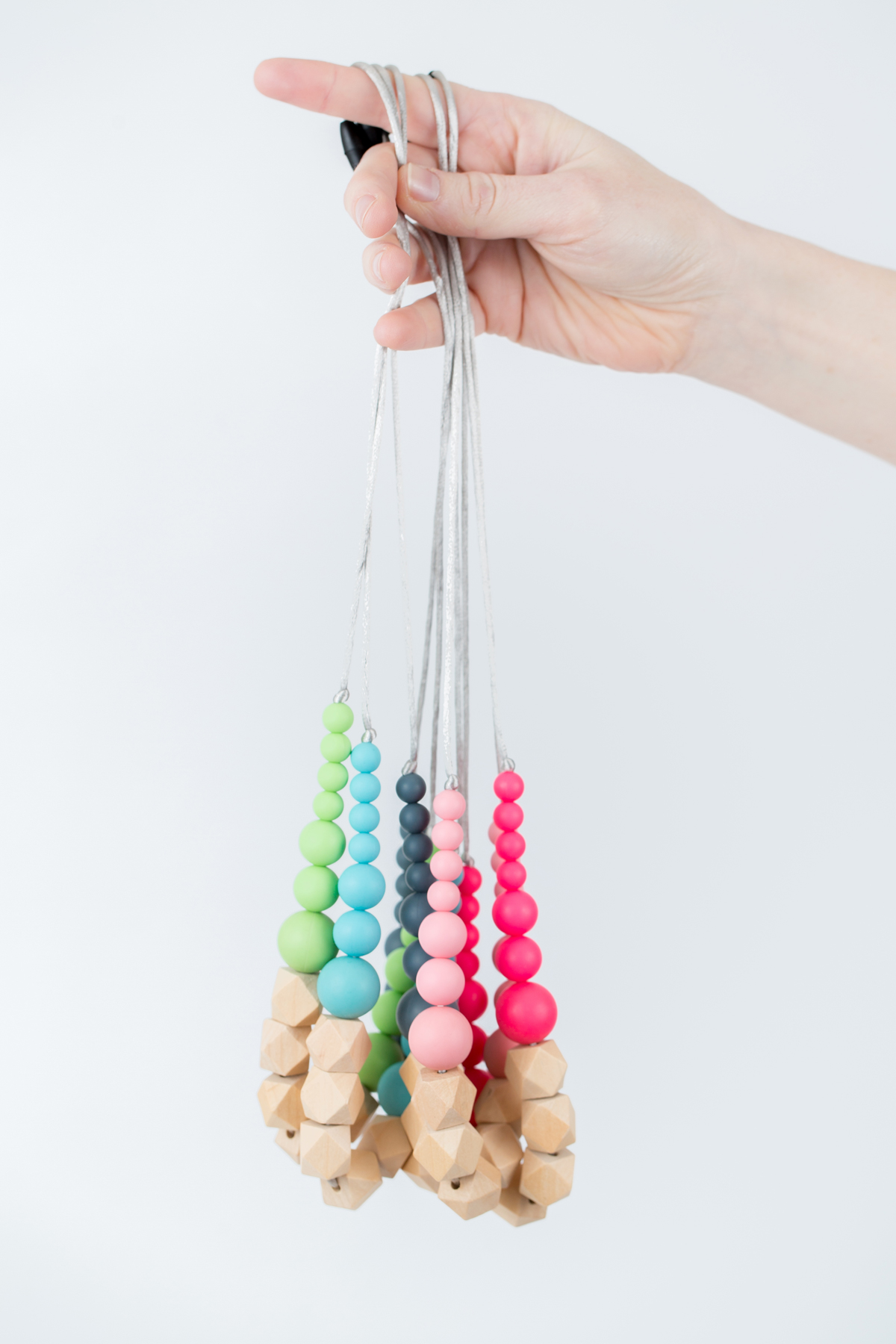 A colourful array of timber and silicone teething necklaces