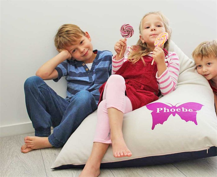 Ari's children enjoying one of the personalised bean bags from her new range