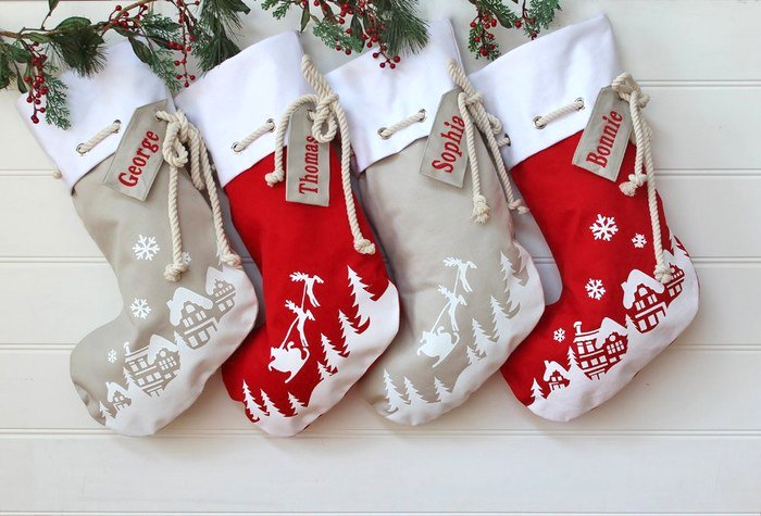Ari enjoys being a part of another family's Christmas tradition: Her range of personalised Christmas stockings by a fireplace