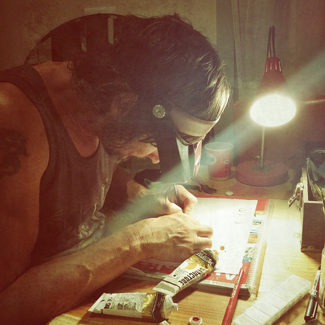 Mike painting in his workshop