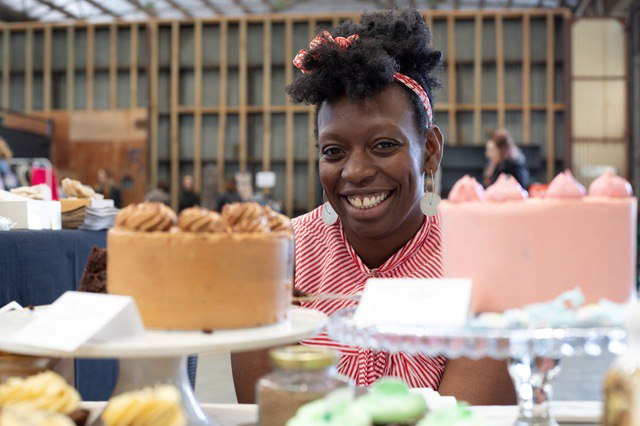 Zee with a collection of her cakes, cookies and other sweet creations at a local market in Melbourne