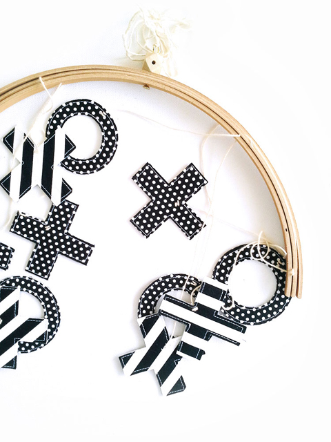 Monochrome naughts and crosses mobile flat-lay