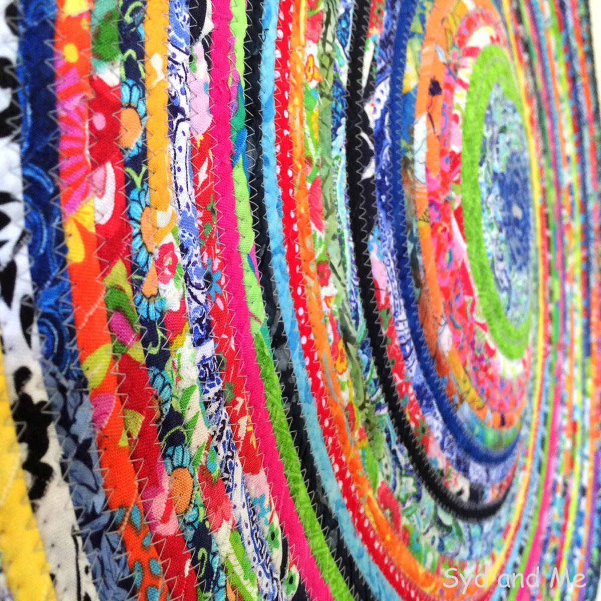 Close-up of a colourful piece of textile wall art