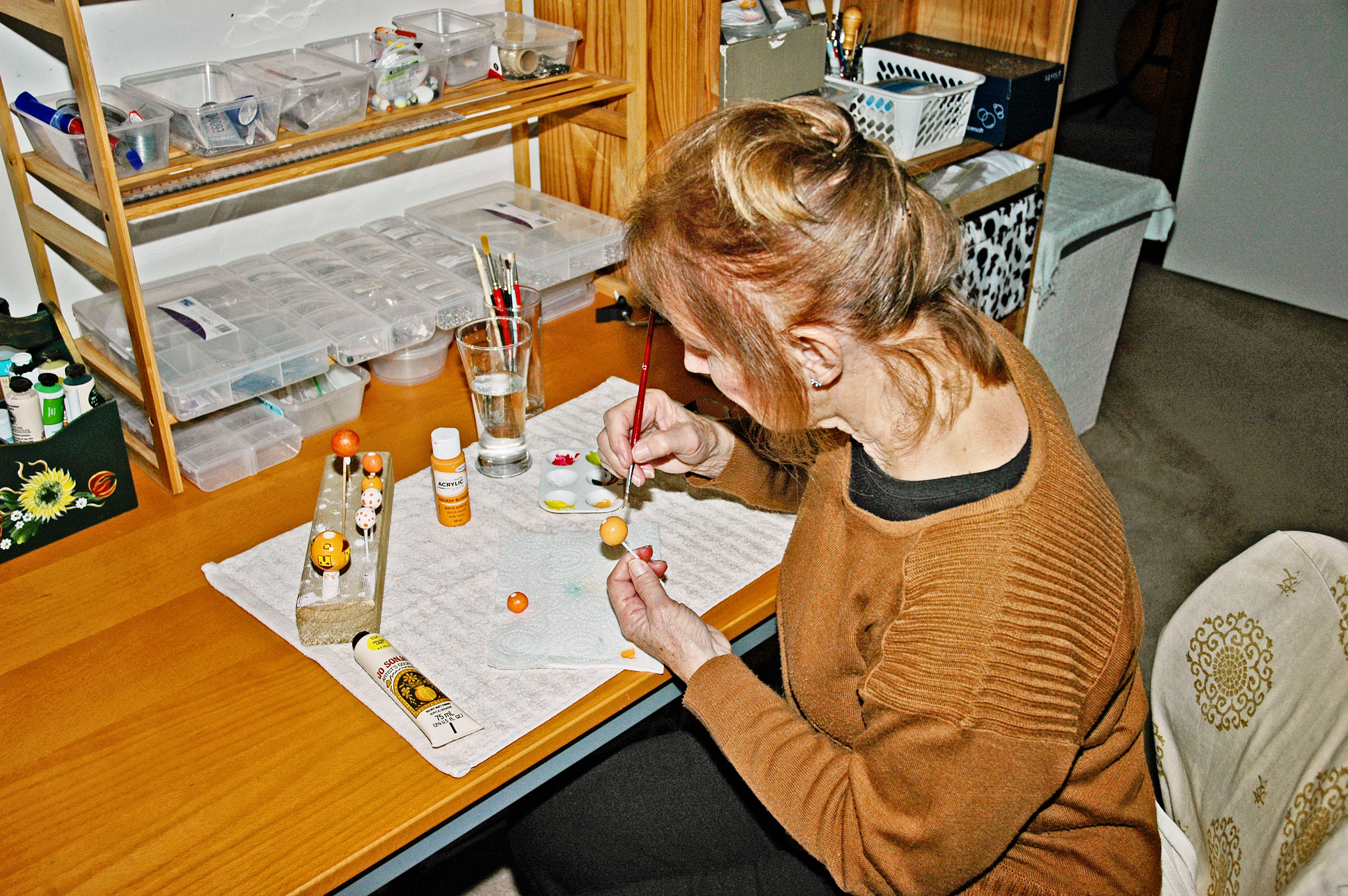 Heather of Silkyecho Pottery painting beads in her home studio