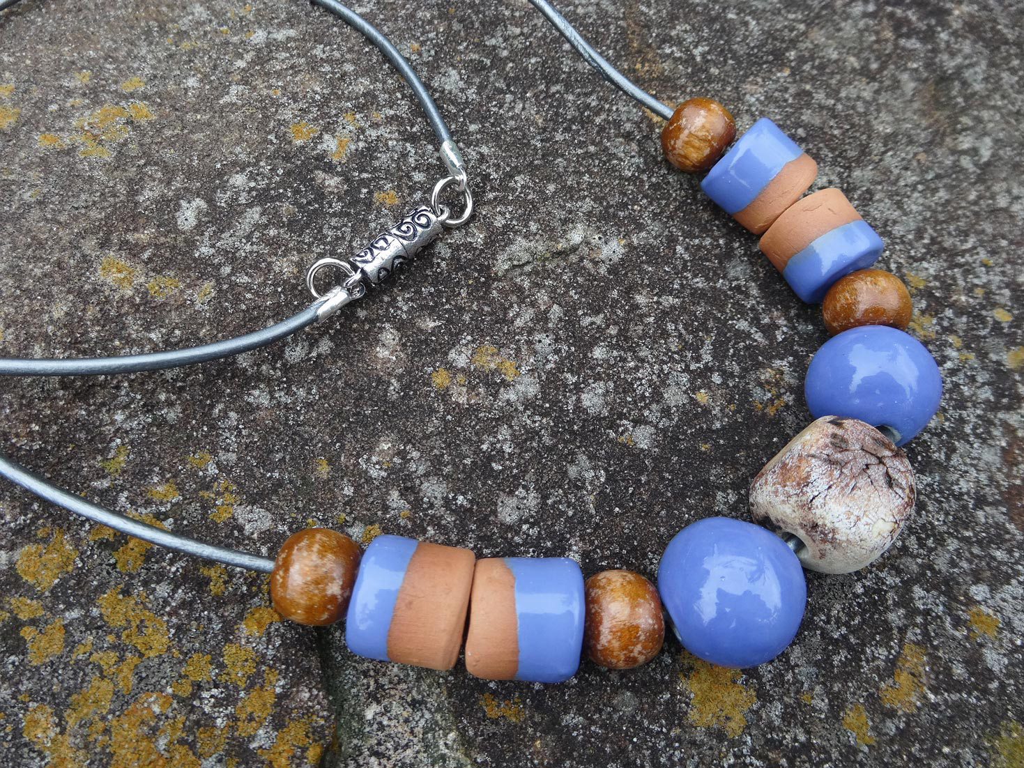 A Silkyecho Pottery necklace of unique ceramic beads in a combination of glaze and organic finishes