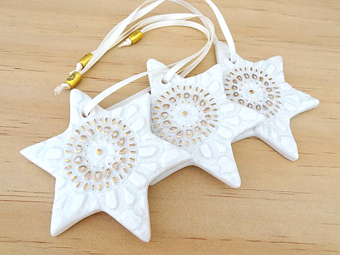 Gold-trim star Christmas decorations