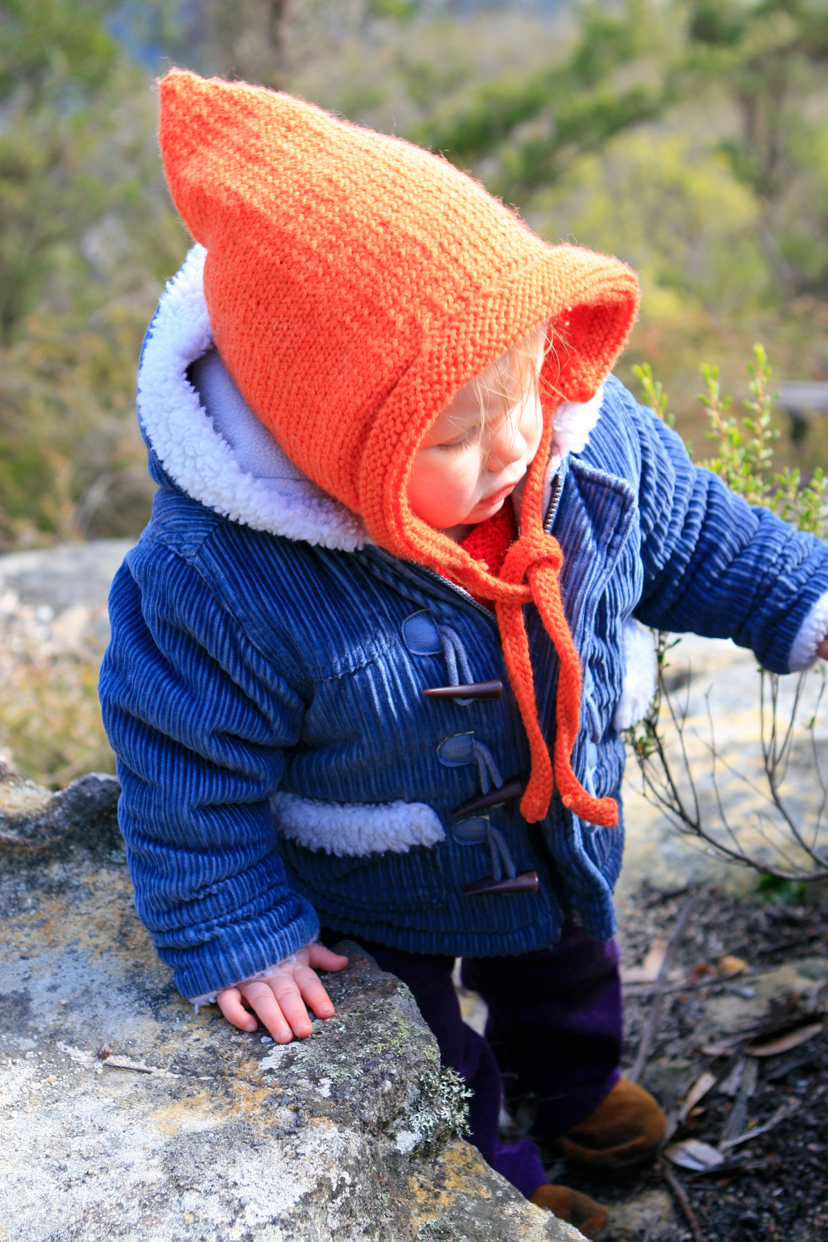 Baby's orange pixie hood by Tigs Togs