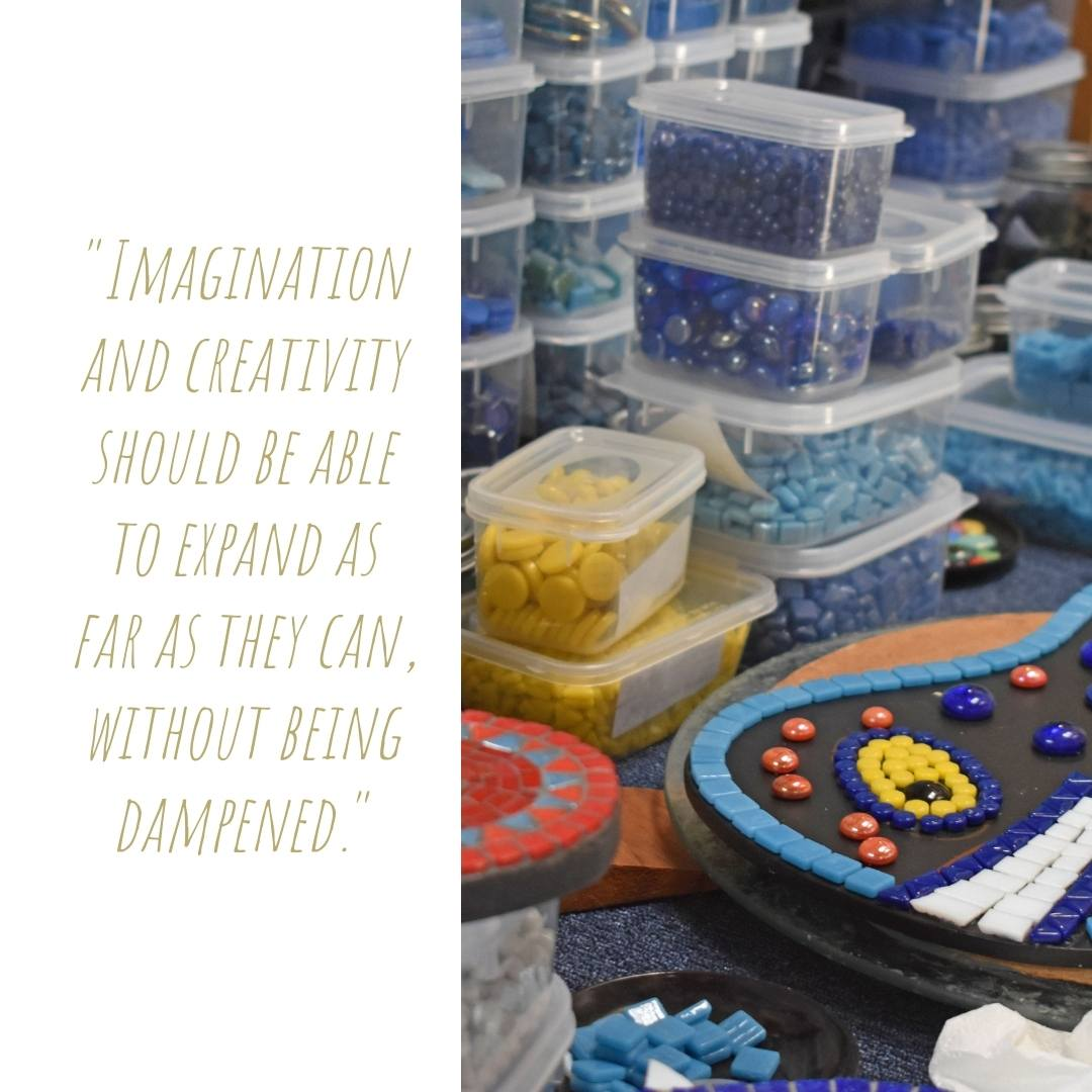 Tubs upon tubs of colourful glass tiles and beads surround a collection of quirky mosaic works in progress on Diane's studio workbench; 'Imagination and creativity should be allowed to expand as far as they can, without being dampened'