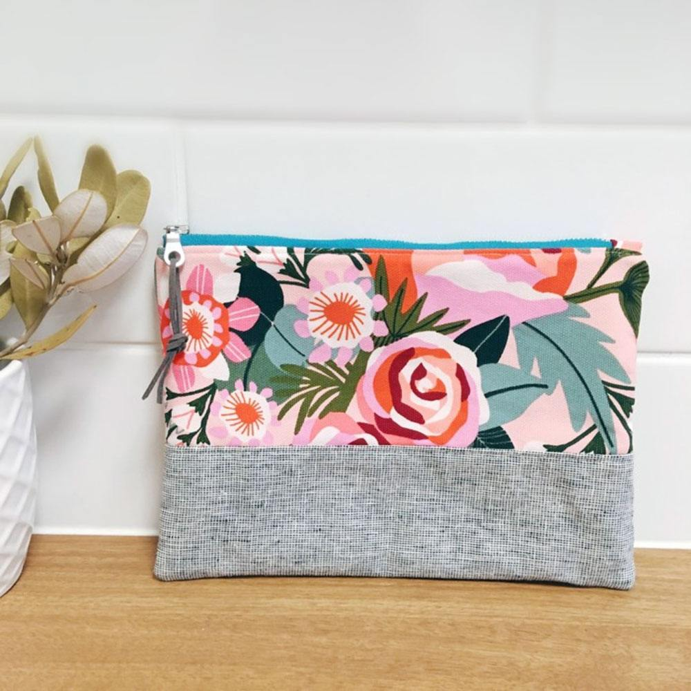 A Banksia and Bloom zippered pouch in grey and bold Kirsten Katz floral print panels