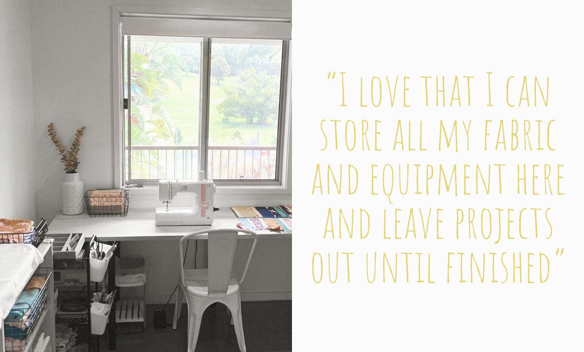 Caroline's home studio with a wooden sewing bench under the window built by her husband for Caroline to sew with a view of the family property: 'I love that I can store all my fabric and equipment here and leave projects out until finished
