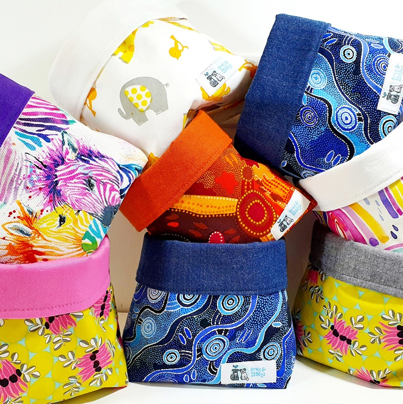 A stack of Birdy & the Boys fabric baskets in a range of bright and colourful prints