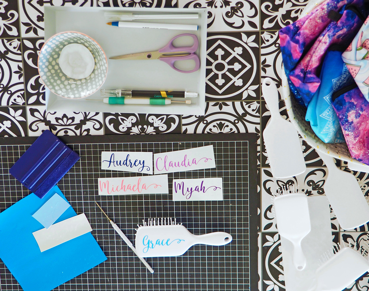 Some tools of the trade; cutting and applying personalised designs to hairbrushes