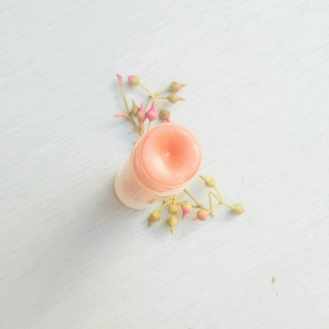 A pretty stick of natural rose gold lip tint handmade by bee one of a kind