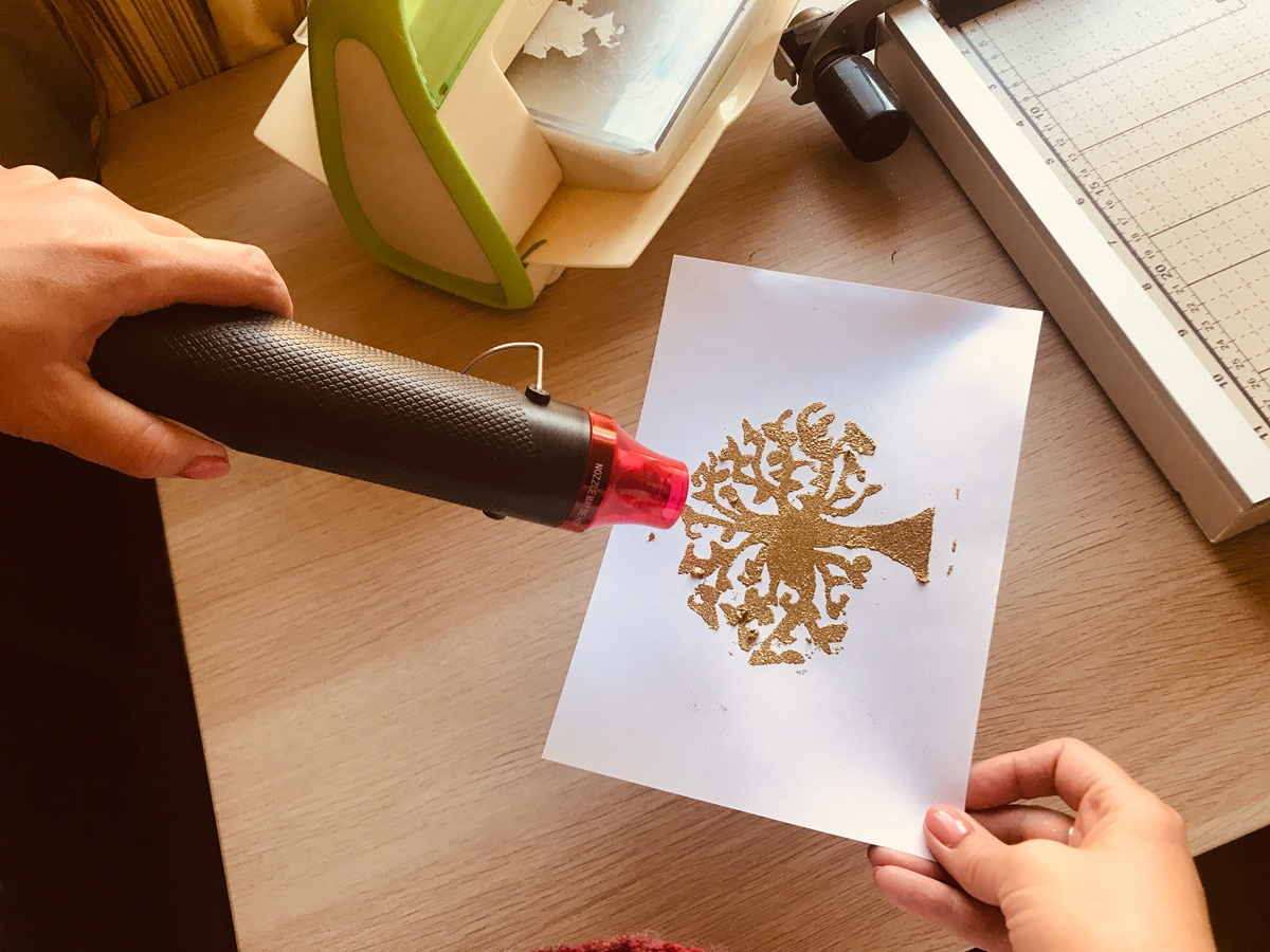 Card-making process: setting the embossing powder with heat
