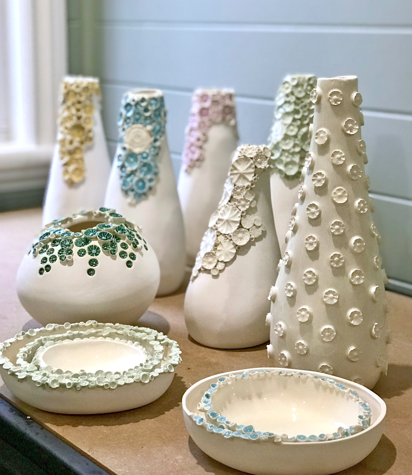 Hand-built earthenware vases and bowls by with 3D barnacle-like decorations by ClayPress Ceramics
