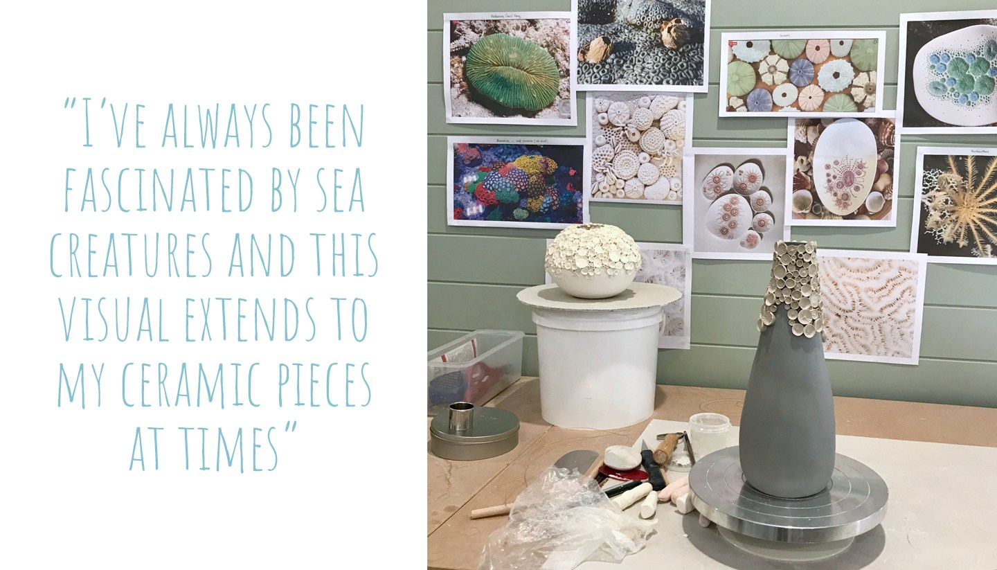 A ceramic vase on the potter's wheel to be decorated, images of corals and sealife adorn the walls in the background; 'I've always been fascinated by sea creatures and this visual extends to my ceramic pieces at times