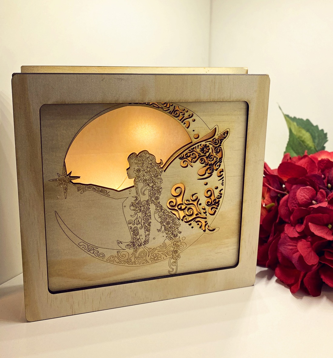 One of Esther story book laser cut light boxes featuring an intricately details fairy