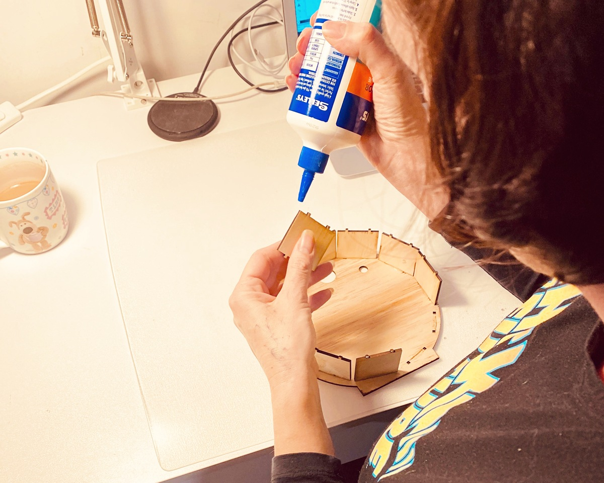 Esther glues each piece of her timber light boxes together by hand
