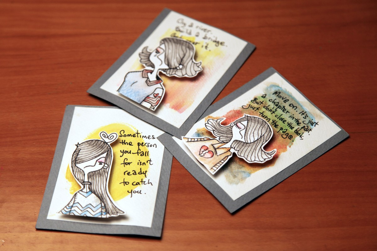A range of card-mounted illustrations with positive messages about love and heartbreak