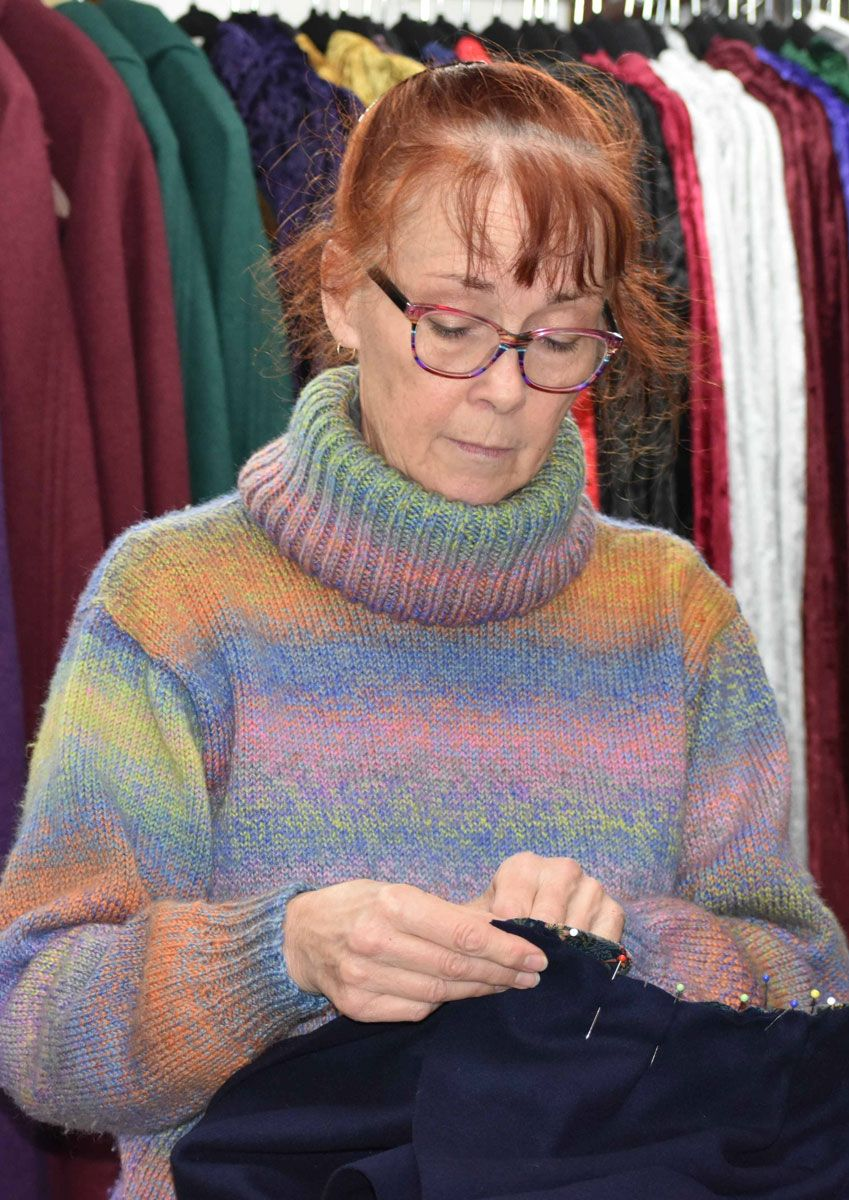 Terry at work pinning one of her wool cloaks