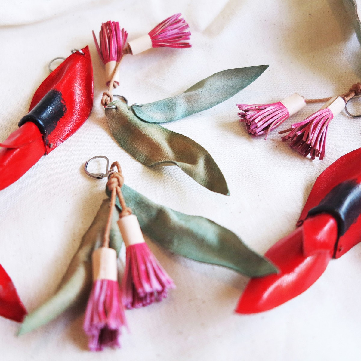 Flowering gum and Sturt Desert Pea Australian botanical inspired artisan leather earrings handcrafted in Adelaide by DONE by Matea