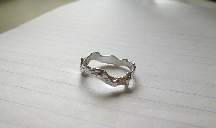 Early jewellery work by Matea; a silver ring with flowing organic lines and textures