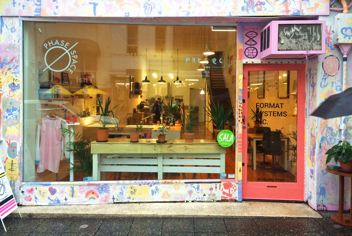 The colourful facade and window display of Matea's early venture; an urban retail space for local artists in downtown Adelaide, called 'Phase Space'