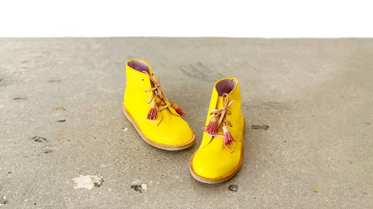 Children's bright yellow boots hand crafted by DONE by Matea