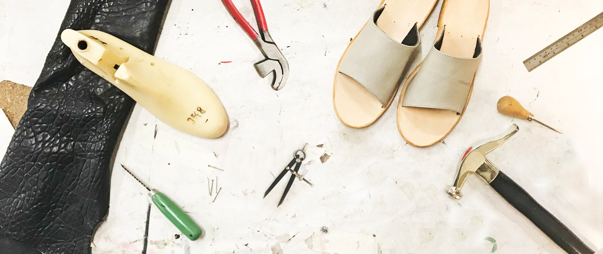 Aerial view of Matea's workbench with shoes in progress and tools of the trade