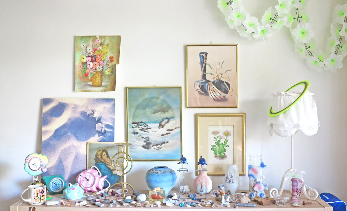 A vignette of Matea's collected inspiration including rocks, shells, and second hand art and objects