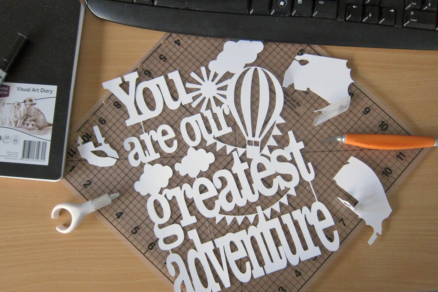 Work in progress: 'You are our greatest adventure' nursery papercut art