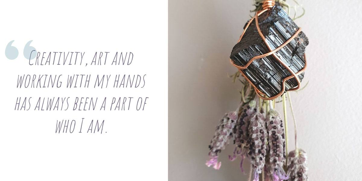 A bunch of dried lavender hanging with a large copper-wire wrapped crystal; 'Creativity, art and working with my hands has always been a part of who I am.'
