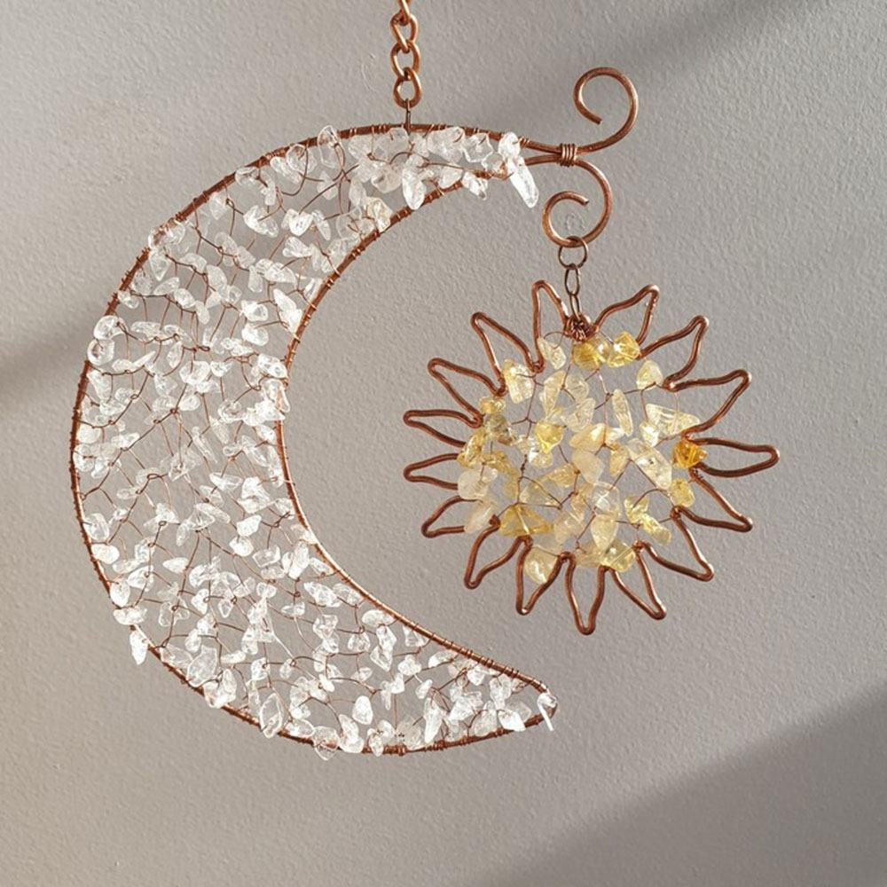 A Moon and sun copper-wire-wrapped crystal sun catcher by Esse Lux