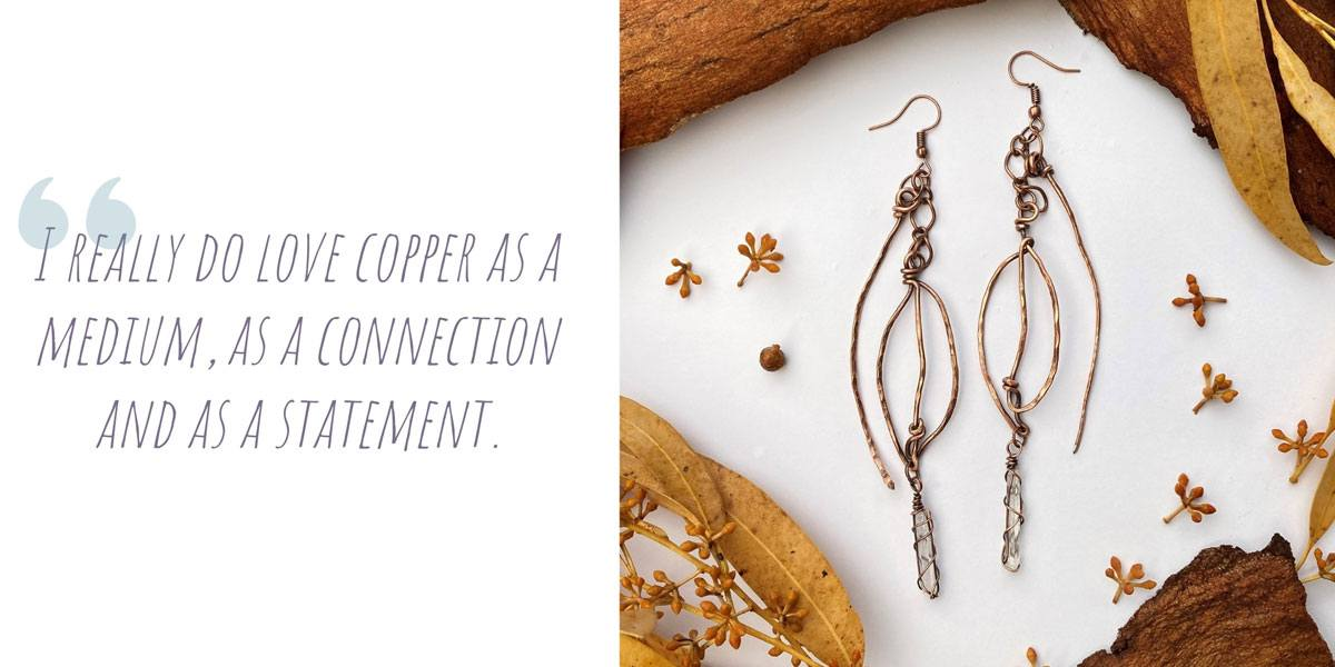 A pair of copper dangle earrings with small clear crystal details; 'I really do love copper as a medium, as a connection and as a statement'