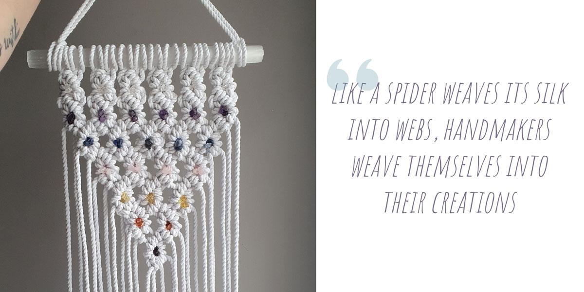 A macrame wall hanging with coloured crystals woven into the details; 'Like a spider weaves its silk into webs, handmakers weave themselves into their creations'