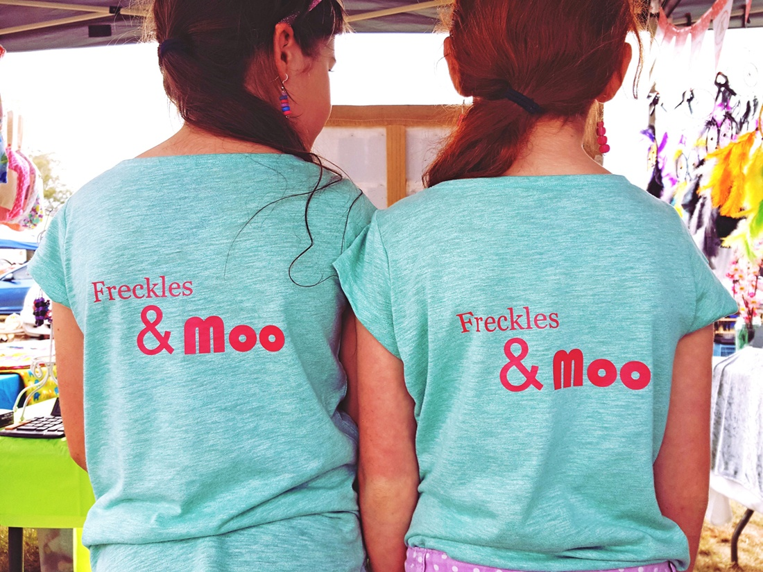 Sisters, Jorja and Grace in their Freckles & Moo-branded shirts at a local Queensland market.