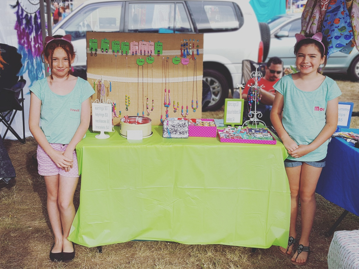 Sister makers, Freckles & Moo manning their market stall in Jimboomba, QLD