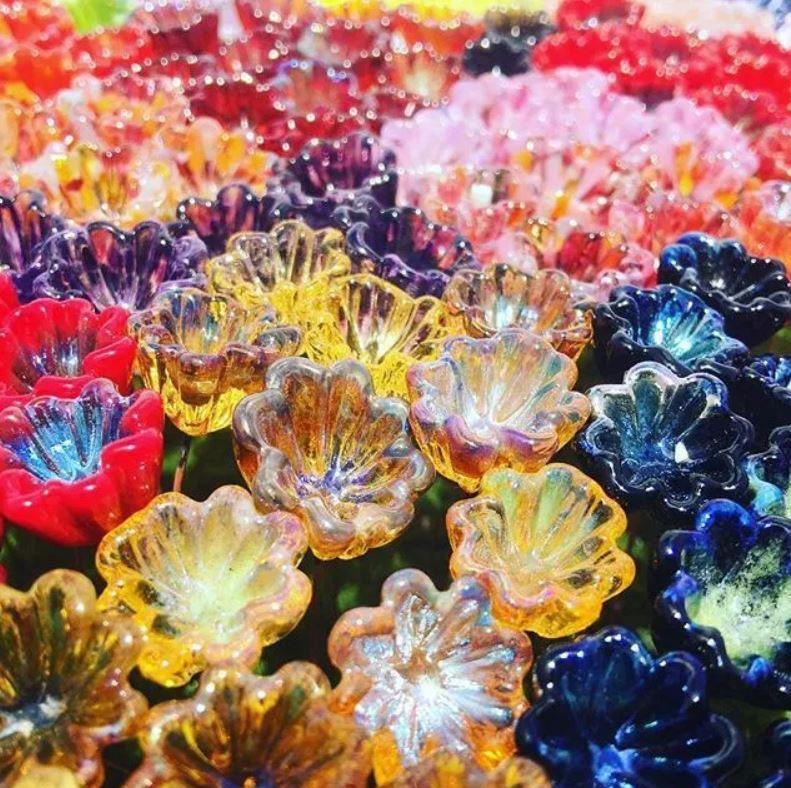 A sea of fused glass flowers by Hextasy Glass
