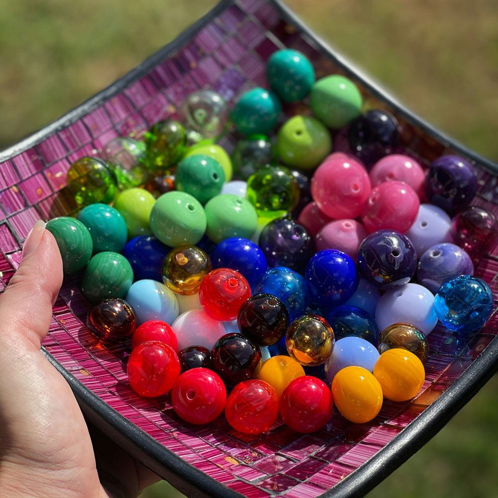 A collection of colourful glass beads made by Samantha at Hextasy Glass